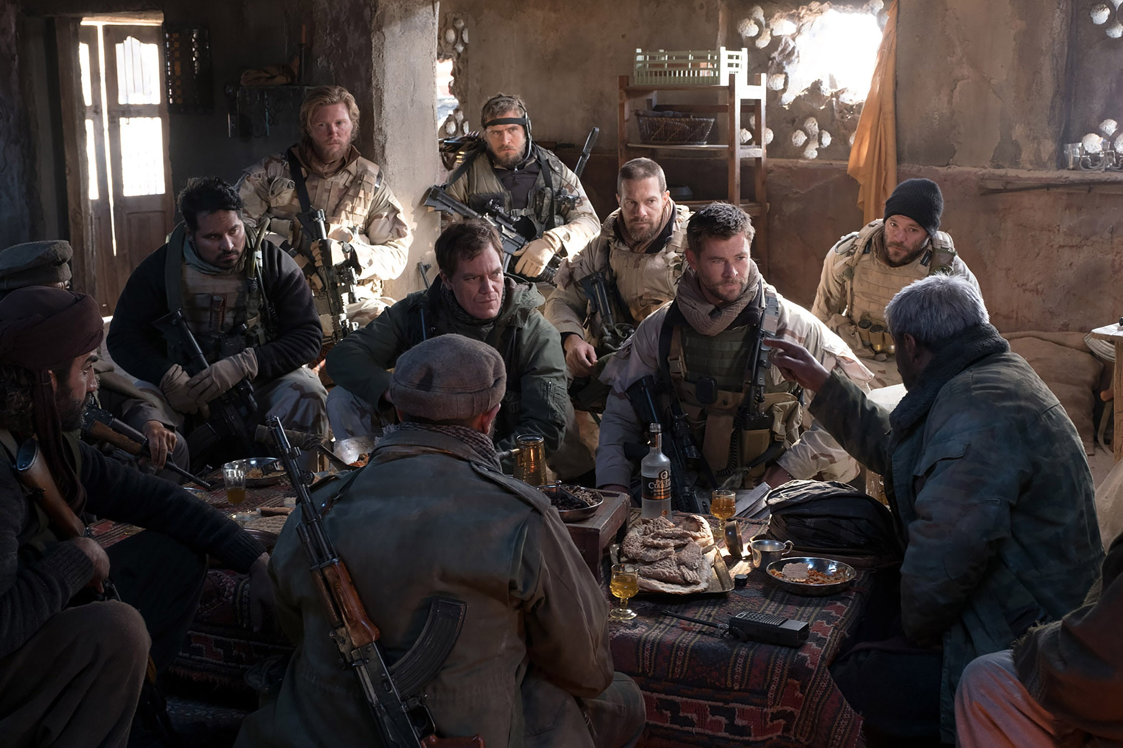 "(L-r) MICHAEL PEÑA as Sam Diller, THAD LUCKINBILL as Vern Michaels, MICHAEL SHANNON as Cal Spencer, JACK KESY as Charles Jones, GEOFF STULTS as Sean Coffers, CHRIS HEMSWORTH as Captain Nelson and AUSTIN HÉBERT as Pat Essex in Jerry Bruckheimer Films', Black Label Media' and Alcon Entertainment's war drama ""12 STRONG,"" a Warner Bros. Pictures release. Photo by David James"